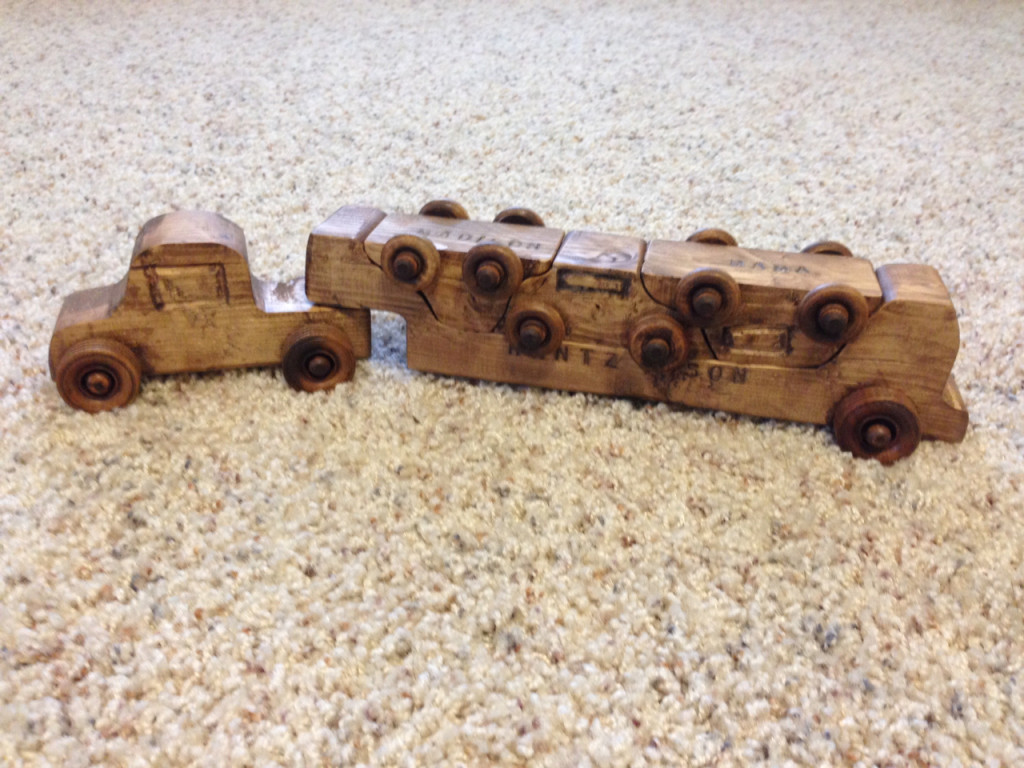 Assemble your car carrier toy for transport.