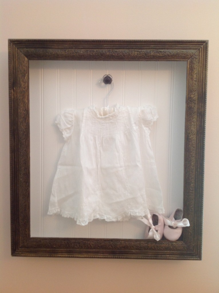 Madison's shadow box to show off her Nana's baby dress.