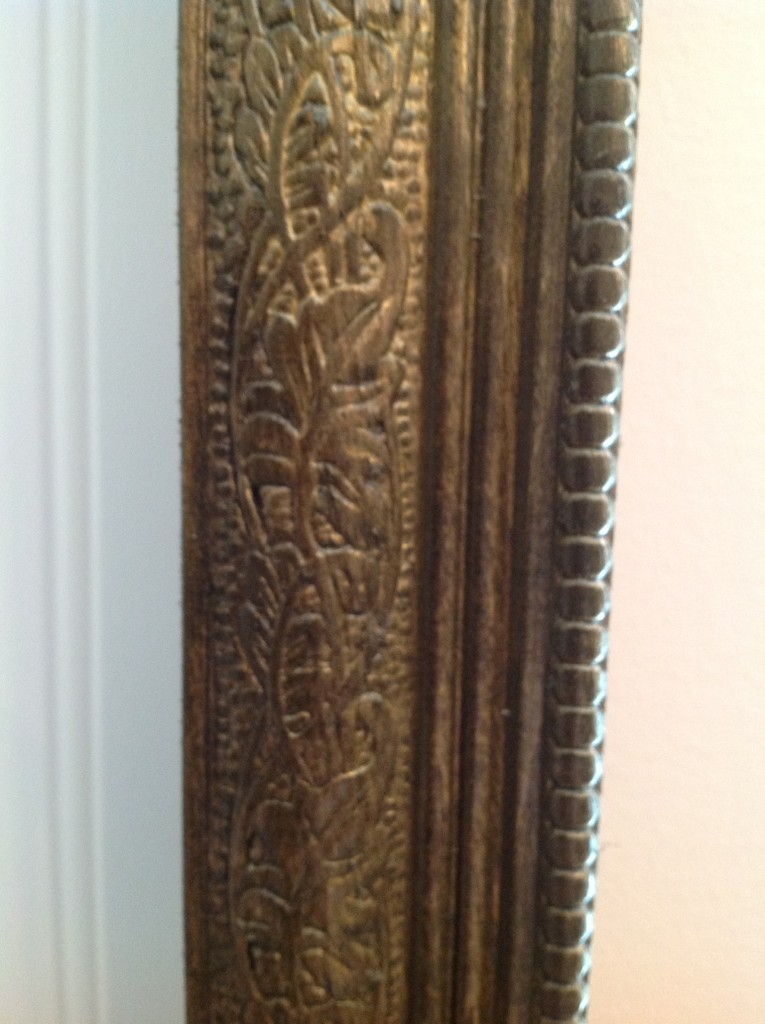 This is a closeup of the gold glazing that we used over espresso stain on the trim.