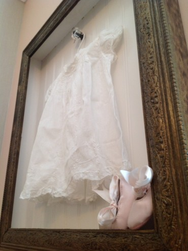 This shadow box was made to hold Madison's Nana's baby dress.