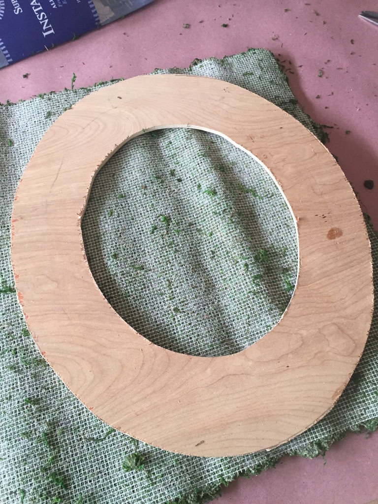 Lay the letter onto the moss mat
