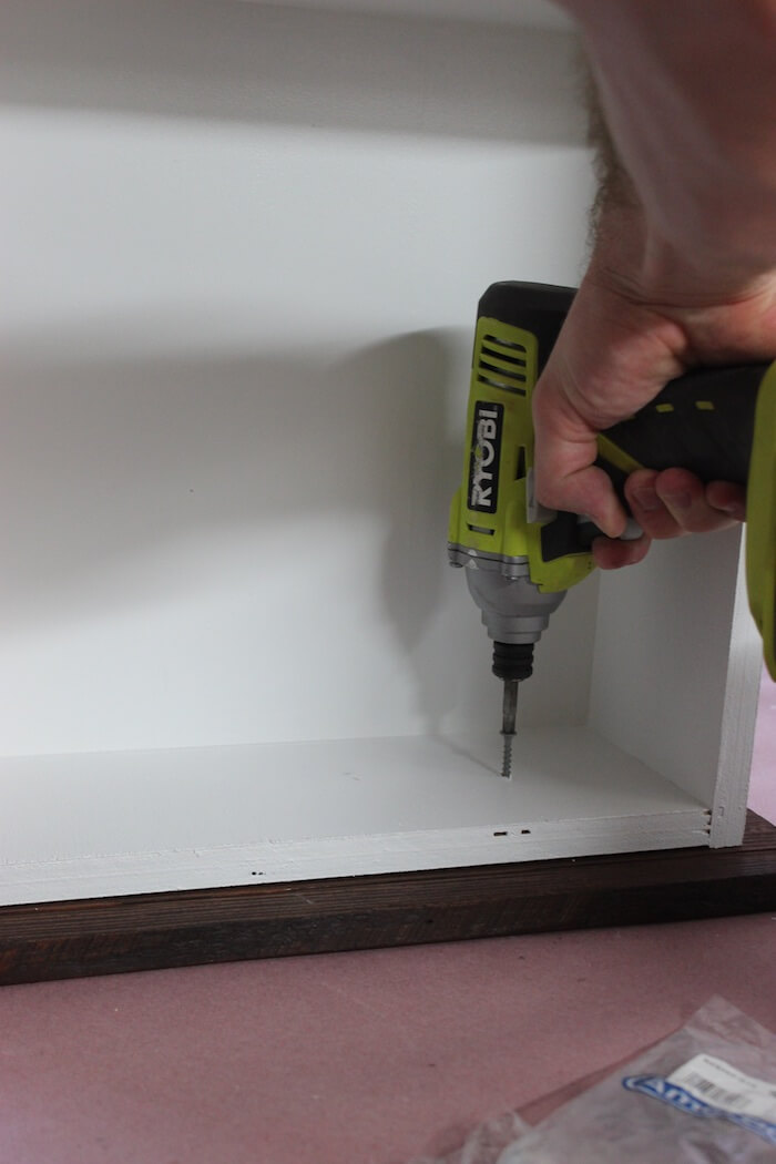"Secure drawer front with 1-1/4"" screws"