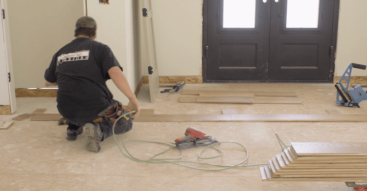 Once the straight line is established throughout the house, the rest of the flooring can be laid off of that. In order to install the flooring on the groove ...