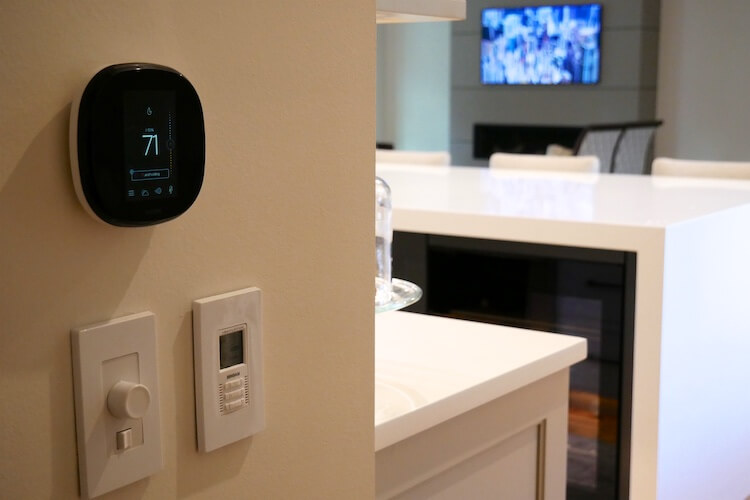 Thermostat and volume control adjacent to kitchen 1